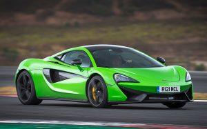 metallic green Lotus sport car at a race track